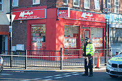 © Licensed to London News Pictures. 02/11/2018. Lewisham, UK. The scene where police have launched an investigation after a teenager was fatally stabbed at Morleys takeaway in Bellingham, Lewisham. Photo credit: Grant Falvey/LNP