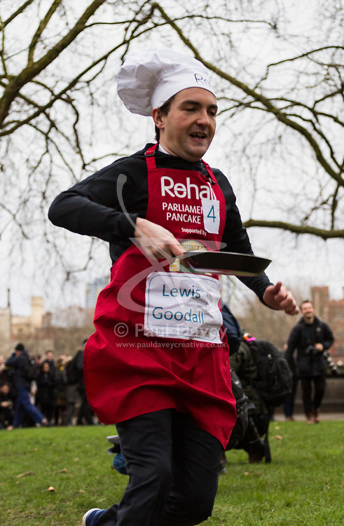 MPs and members of the House of Lords compete in the annual Rehab pancake race, a relay of eleven laps in Victoria Tower Gardens adjacent to the Houses of Parliament in London. The race is held every year on Shrove Tuesday and was won by the Media team. PICTURED: Lewis Goodall from Sky News. London, February 13 2018.
