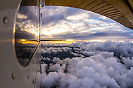 Flying during sunset in Central America along the Pacific coast in a Cessna.