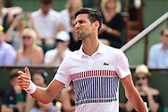 Novak Djokovic (SRB) struggles in the first set during the preliminary rounds of the Roland Garros Tennis Open 2017 at Roland Garros Stadium, Paris, France on 2 June 2017. Photo by Jon Bromley.