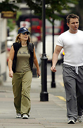 Jun 18, 2004; London, England, UK;  ! Call for Price! Former Spice Girl GERI HALLIWELL tries to hide behind her personal trainer in Notting Hill, London (Credit Image: © GS001/ZBP/ZUMAPRESS.com)