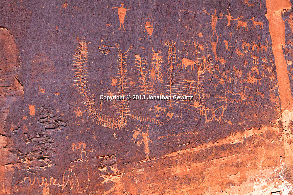 Prehistoric Indian writing from the Archaic and Fremont cultures, as seen on canyon walls along Utah Highway 279 which runs along the Colorado River near Moab, Utah. WATERMARKS WILL NOT APPEAR ON PRINTS OR LICENSED IMAGES.
