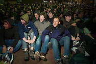 "As Basque police (Ertzaintza) members approach, people sits down, gathers around the 8 youths who have been sentenced to six years in jail for having been members of the Basque pro-independence youth organization SEGI ('Keep on' in basque language). Donostia-San Sebastian (Basque Country) April, 19th 2013. As an arrest warrant was issued against them and they could be arrested any time, young people gathered them to support and to prevent them from being arrested. The sentence stated: ""Membership to terrorist organization"". (Gari Garaialde/Bostok Photo)."