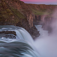 A fiery dawn sets the sky ablaze over the waterfall Gullfoss, located on the Hvita River in southwest Iceland.