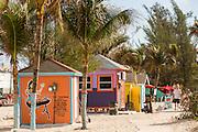 Pastel colored kiosks along Junkanoo Beach in Nassau, Bahamas