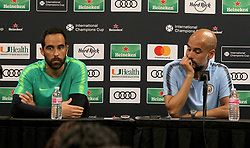 July 27, 2018 - Miami Gardens, FL, USA - Manchester City head coach Pep Guardiola, right, and goalkeeper Claudio Bravo during a news conference in advance of an International Champions Cup match against FC Bayern at Hard Rock Stadium in Miami Gardens, Fla., on Friday, July 27, 2018. (Credit Image: © Pedro Portal/TNS via ZUMA Wire)