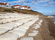 Coastal defences normally covered by shingle exposed by winter storms at Thorpeness, Suffolk, England in November 2013