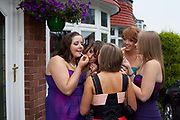 Grace Meehan, 17, and friends from Whitley Bay High School, prepare to celebrate their leaving prom at the Life conference centre, Newcastle. In recent years American style prom nights to celebrate graduation from high School have been gaining popularity in the UK.