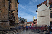 Tourist groups and visitors passing the St. George's Square (Namesti U Svateho Jiri) at Prague Castle. On the left St. Vitus Cathedral. This cathedral is a prominent example of Gothic architecture and is the largest and most important church in the country.