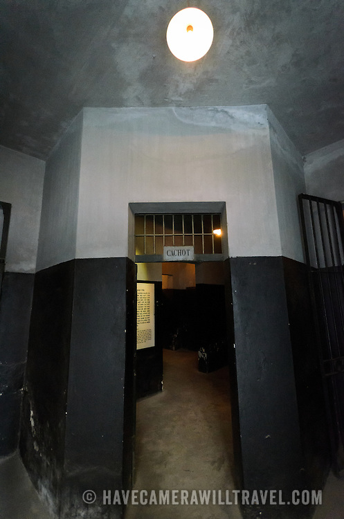 "The entrance to the so-called dungeon of Hoa Lo Prison. Used for solitary confinement and ""special"" treatment, these rooms were dark and small. Inmates were shackled in place in their cells.  Hoa Lo Prison, also known sarcastically as the Hanoi Hilton during the Vietnam War, was originally a French colonial prison for political prisoners and then a North Vietnamese prison for prisoners of war. It is especially famous for being the jail used for American pilots shot down during the Vietnam War."