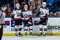 KELOWNA, BC - MARCH 6: Kyle Topping #24, Pavel Novak #11 and Kaedan Korczak #6 of the Kelowna Rockets celebrate a third period goal against the Seattle Thunderbirds at Prospera Place on March 6, 2020 in Kelowna, Canada. (Photo by Marissa Baecker/Shoot the Breeze)