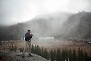 Obadiah Reid takes pictures in the mist above McCurdy Park, Lost Creek Wilderness, Colorado.