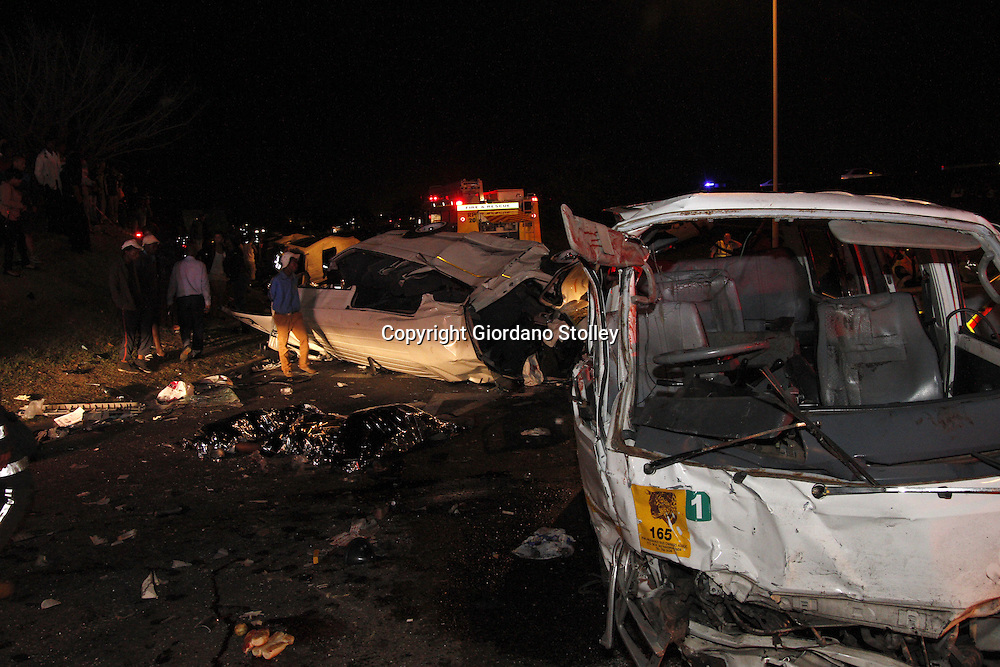 DURBAN - 5 September 2013 - The bodies of  three of the  24 people who were killed when a lorry's brakes failed on Field's Hill in Pinetown and ploughed through four taxis and a car lie near the wreckage. Picture: Allied Picture Press/APP ***EDS -- NOTE GRAPHIC CONTENT ---***