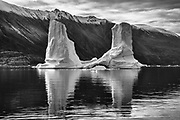 Black and white iceberg and arctic landscape of the east coast of Greenland,Scoresby Sound, East Greenland
