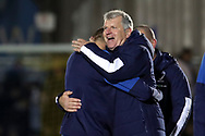 AFC Wimbledon manager Glyn Hodges hugging AFC Wimbledon attacker Marcus Forss (15) and smiling during the EFL Sky Bet League 1 match between AFC Wimbledon and Doncaster Rovers at the Cherry Red Records Stadium, Kingston, England on 14 December 2019.