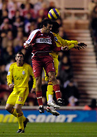 Photo: Jed Wee.<br />Middlesbrough v Liverpool. The Barclays Premiership. 18/11/2006.<br /><br />Middlesbrough's Julio Arca (L) makes his first start at the Riverside as he beats Jermaine Pennant to the ball.