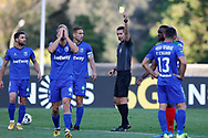 Referee shows yellow card to Henrique during the Liga NOS match between Belenenses SAD and Maritimo at Estadio do Jamor, Lisbon, Portugal on 17 April 2021.