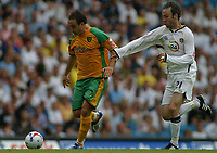 Photo: Paul Thomas.<br /> Leeds United v Norwich City. Coca Cola Championship.<br /> 05/08/2006.<br /> <br /> Lee Croft (L) of Norwich gets away from Shaun Derry.