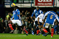Photo: Gareth Davies.<br />Portsmouth v Everton. The Barclays Premiership. 09/12/2006.<br />Portsmouth's Linvoy Primus (L) controls the ball with his head.