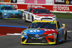 September 30, 2018 - Concord, North Carolina, United States of America - Kyle Busch (18) races during the Bank of America ROVAL 400 at Charlotte Motor Speedway in Concord, North Carolina. (Credit Image: © Chris Owens Asp Inc/ASP via ZUMA Wire)