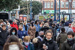 © Licensed to London News Pictures. 02/12/2020. London, UK. Shoppers are out in force in Kingston, South West London on the first day of the new 3-tiered system as shops are given the green light to stay open 24 hours a day for the Christmas period. The Government has announced the end of lockdown and introduced a new 3-tiered system for England, which came into effect this morning (Wednesday 2nd December). All non-essential shops, restaurants, gyms, pubs if serving food and golf courses are allowed to reopen again. Photo credit: Alex Lentati/LNP