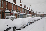 People in Kings Heath head out to enjoy the heavy snow fall on Sunday 10th December 2017 in Birmingham, United Kingdom. Deep snow arrived in much of the UK, closing roads and making driving treacherous, while many people simply enjoyed the weather.