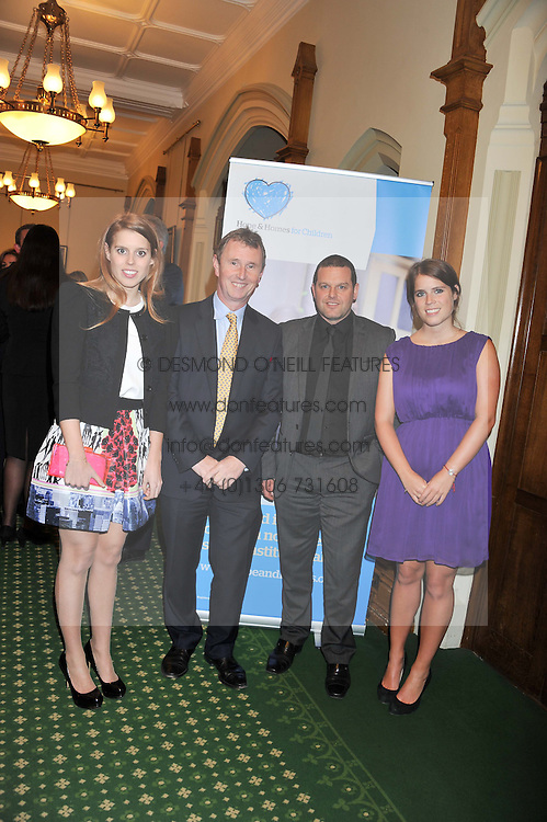 Left to right, PRINCESS BEATRICE OF YORK, NIGEL EVANS MP - Deputy Speaker House of Commons, MARK WADDINGTON Chief Executive Hope and Homes for Children and PRINCESS EUGENIE OF YORK at a reception for The Mirela Fund in partnership with Hope and Homes for Children hosted by Natalie Pinkham in The Churchill Room, House of Commons, London on 30th April 2013.