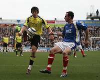 Photo: Lee Earle.<br /> Portsmouth v Manchester City. The Barclays Premiership. 11/03/2006. City's Joey Barton (L) clears from Andy O'Brien.