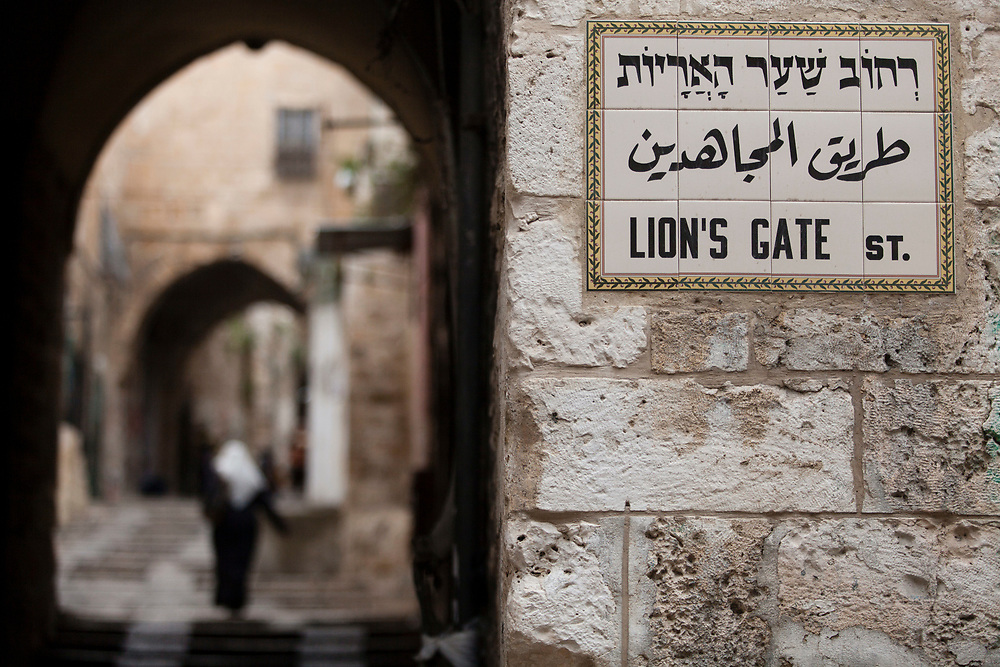 A Palestinian woman walks through an alley near the Lion's Gate in the Old City of Jerusalem, Israel, on April 22, 2013.