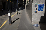 With the UK death toll reaching 34,813, with a further 541 victims in the last 24hrs, the governments pandemic lockdown has eased to another stage and a corporate office displays a social distance requirement notice on Throgmorton Street in the City of London, the capitals financial district, on 1st June 2020, in London, England.