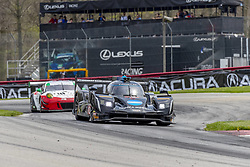 May 6, 2018 - Lexington, Ohio, United States of America - The Konica Minolta Business Solutions USA Cadillac DPI car races through the turns during the Acura Sports Car Challenge race at the Mid-Ohio Sports Car Course in Lexington, Ohio. (Credit Image: © Walter G Arce Sr Asp Inc/ASP via ZUMA Wire)