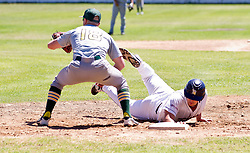 Wesley Greeff of the Bellville Tygers dives back to first base after an attempted steal. Baseman is Kyle Botha of the Bothasig Knights.The Major league game was held at the Tygers' home ground at the PP Smit stadium in Bellville on 23 October 2016. Photo by John Tee/RealTime Images.