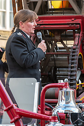 © Licensed to London News Pictures. 23/12/2019. London, UK. London Fire Brigade Commissioner Dany Cotton makes a speech standing on a vintage fire engine at a Guard of Honour event in London. Firefighters from across the UK and several from overseas attended the unofficial event outside the brigades headquarters in Union Street. Commissioner Cotton is retiring in the wake of the Grenfell Fire. Photo credit: Peter Manning/LNP
