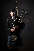 Mark Stanfield with his bagpipes.