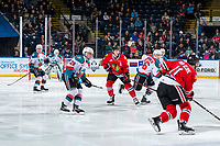 KELOWNA, CANADA - MARCH 3: Michael Farren #16 and Liam Kindree #26 of the Kelowna Rockets check Lane Gilliss #9 of the Portland Winterhawks on March 3, 2019 at Prospera Place in Kelowna, British Columbia, Canada.  (Photo by Marissa Baecker/Shoot the Breeze)