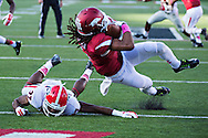 LITTLE ROCK, AR - OCTOBER 18:  Keon Hatcher #4 of the Arkansas Razorbacks catches a pass and runs it in for a touchdown while being covered by Devin Bowman #37 of the Georgia Bulldogs at War Memorial Stadium on October 18, 2014 in Little Rock, Arkansas.  The Bulldogs defeated the Razorbacks 45-32.  (Photo by Wesley Hitt/Getty Images) *** Local Caption *** Keon Hatcher; Devin Bowman