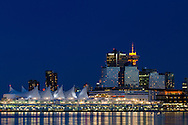 Lights of downtown Vancouver and Canada Place after sunset from Stanley Park in British Columbia, Canada