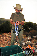 Israel, the Carmel Mountains Hai Bar wildlife sanctuary and breeding centre. Caretaker with a stack of bird ringing rings