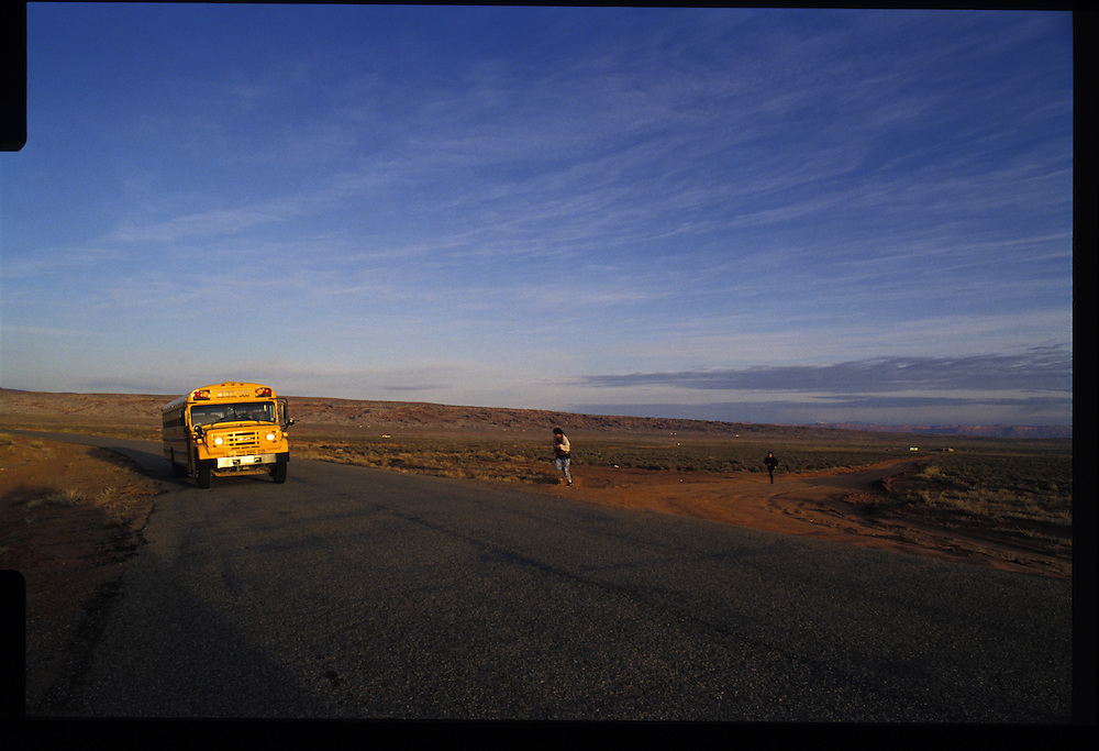 A school bus carries Navajo children not just to classes, but away from the traditions of their elders.  1993 - Olijeto, Utah which is located near Monument Valley.