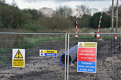 Site of Thames Water pipe laying along River Kennet valley in Reading Berkshire showing Weils disease risk warning sign from rat infestations in this area,