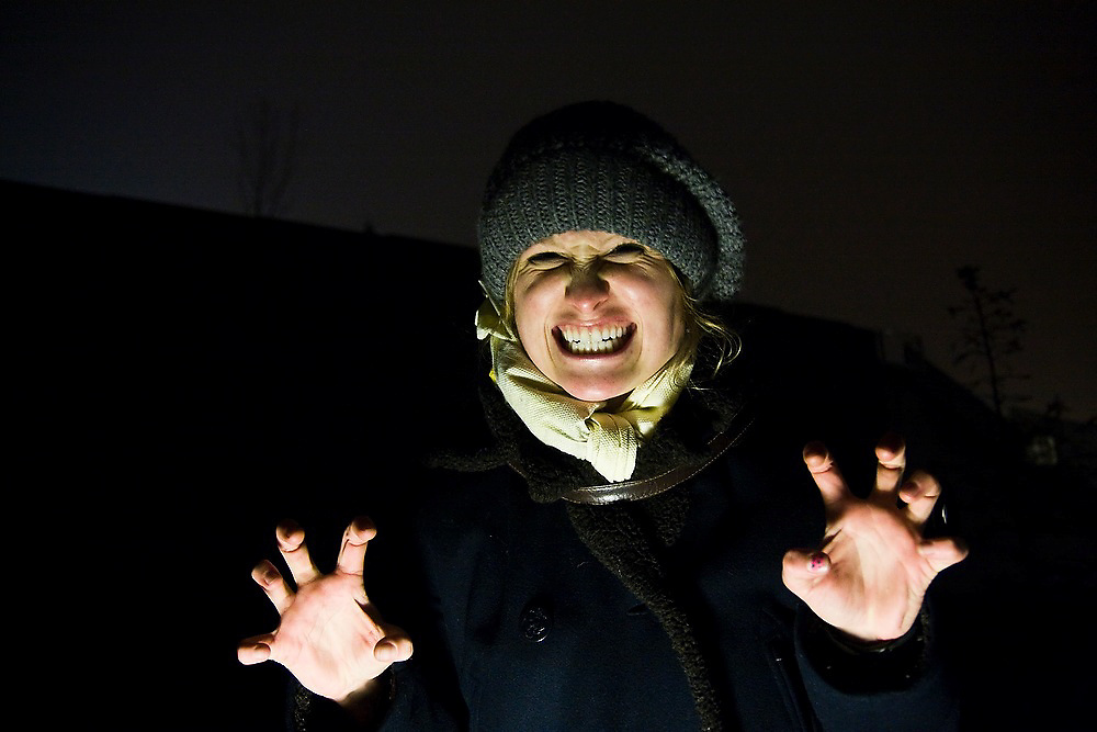 Anna Reiser makes a scary face while exploring the dark corners of downtown Seattle, Washington.