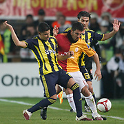 Galatasaray's Arda TURAN (C) and Fenerbahce's Andre Clarindo Dos SANTOS (L), Mehmet TOPUZ (R) during their Turkish superleague soccer derby match Galatasaray between Fenerbahce at the AliSamiYen Stadium at Mecidiyekoy in Istanbul Turkey on Sunday, 28 March 2010. Photo by Aykut AKICI/TURKPIX