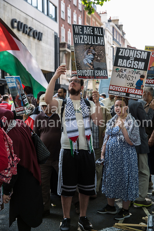 London, UK. 10th June, 2018. Hundreds of people prepare to take part in the pro-Palestinian Al Quds Day march through central London organised by the Islamic Human Rights Commission. An international event, it began in Iran in 1979. Quds is the Arabic name for Jerusalem.