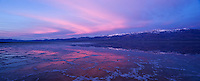 Sunrise reflection in Badwater Basin and Panamint mountains, Death Valley national park, California.