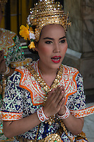 """Erawan Shrine Dancers - Erawan Shrine or """"San Phra Phrom"""" in Thai is a Hindu shrine in Bangkok with a statue of the Hindu creation god Brahma or Phra Phrom as it is known in Thai. The shrine features performances by resident Thai dance troupes who are hired by worshippers for making merit.  Erawan Shrine was built in 1956 so as to eliminate the bad karma that was believed to have been caused by laying the foundations of a hotel being built on the wrong date.  The hotel's construction was delayed by a series of troubles: injuries to laborers, budget and the loss of a Italian marble intended for the building. Another dark mark on the location was that Ratchaprasong Intersection had once been used to publicly display and humiliate criminals."""