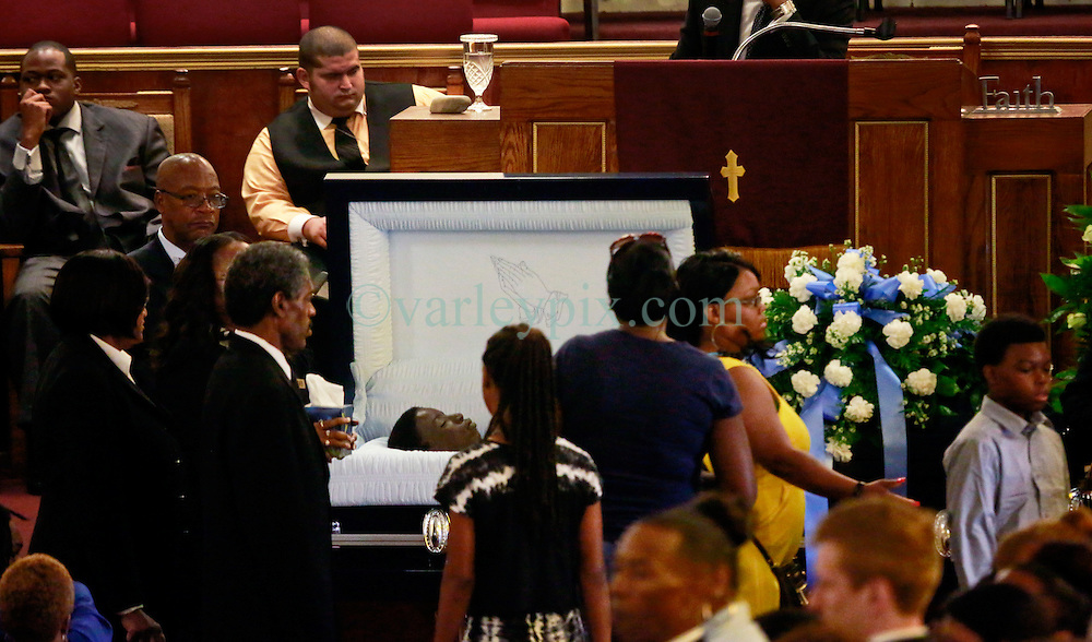 14 May 2014. New Orleans, Lousiana. <br /> Funeral for teenage shooting victim Miqual Jackson at the New Hope Baptist Church. 14 years old Jackson was shot in the back of the head May 5th and died shortly afterwards. His 15 year old brother  Lamichael was hit in the leg and survived. 52 year old Gregory Johnson is wanted on 1st degree murder charges. Randy Pittman, 49, an associate of Johnson's was arrested on 3 counts of being a principal to 1st degree murder. The New Hope Baptist Church witnessed the funeral of 1 year old Londyn Samuels who was also gunned down in cold blood on the streets of New Orleans 8 months ago.<br /> Charlie Varley/varleypix.com