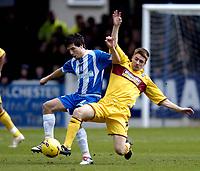Photo: Olly Greenwood.<br />Colchester United v Burnley. Coca Cola Championship. 24/02/2007. Colchester's Kem Izzet and Burnley's Wade Elliot