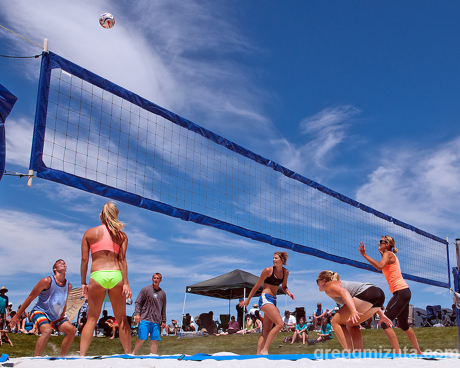 Jack Terry waits for the ball has his teammates (L to R: Sarah Baugh, Brock Hall, Kaitlyn Oliver) look on during the Payette River Games volleyball competition at Kelly's Whitewater Park in Cascade, Idaho on June 21, 2014.