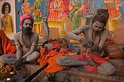 Sadhus / Babbas on the banks of the Ganges on 21st December 2009 in Varanasi / Benares, Uttar Pradesh, India. According to Hindu mythology, Varanasi was founded by Shiva, one of three principal deities along with Brahma and Vishnu, and is seen as a significant and holy place to followers of the Hundu faith.