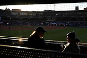 A mother and daughter attend the Hartford Yard Goats baseball season opener against the Portland Sea Dogs in Hartford, Conn.